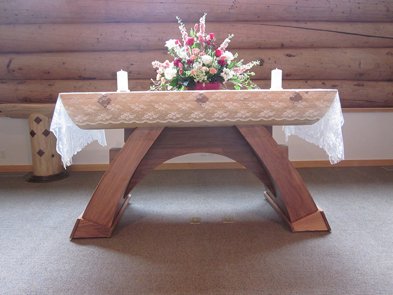 Altar with Tablecloth and Flowers