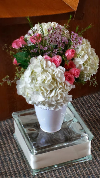 Flowers in White Vase on Glass Block