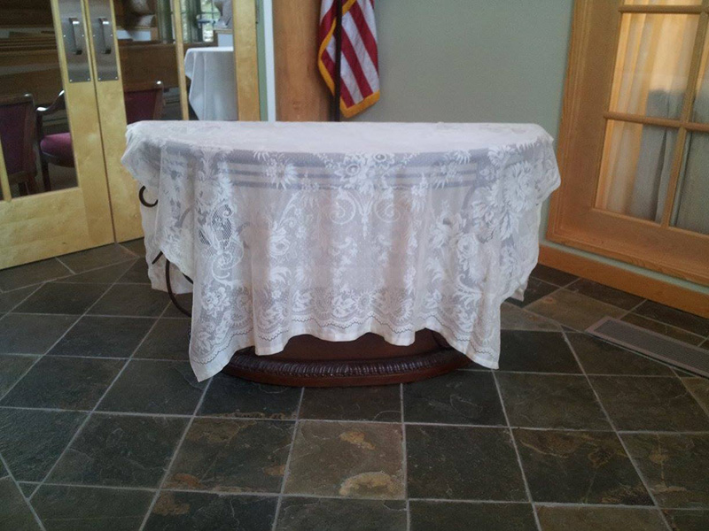 Glass Table with Lace Tablecloth