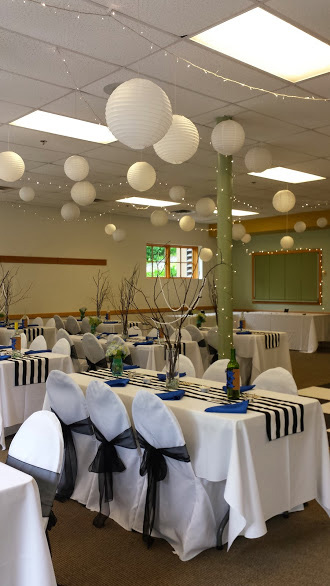 White Chair Covers and Black Taffeta Bows